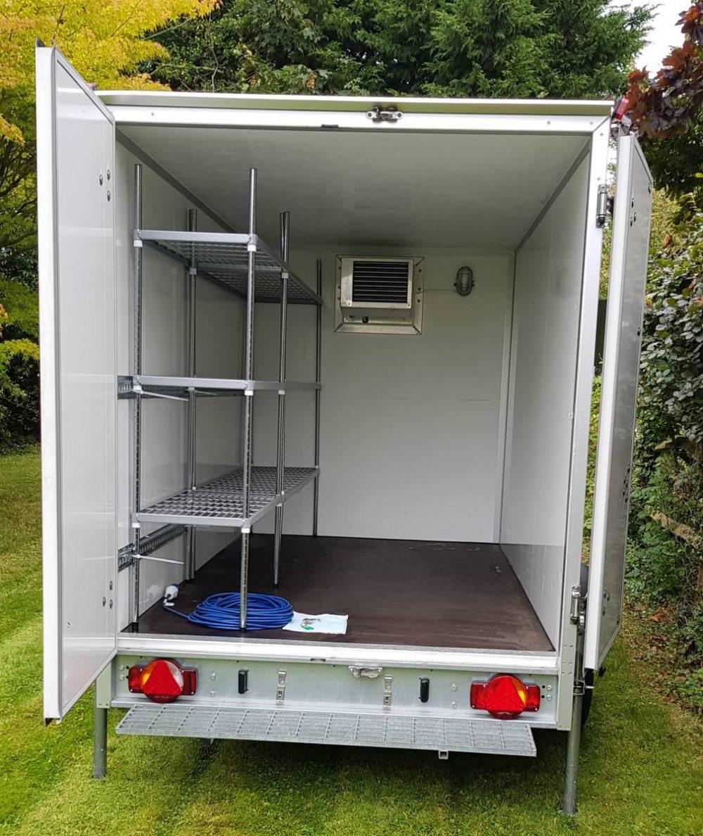 The inside of an empty fridge trailer