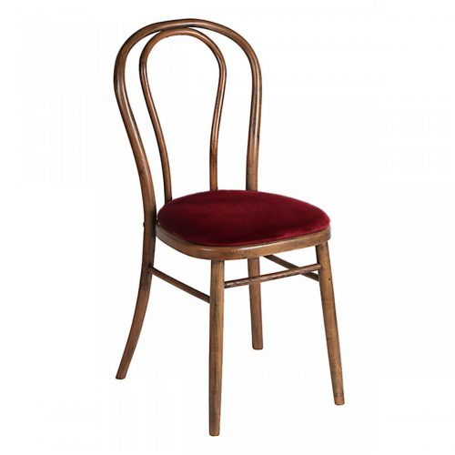Loop back chair with red seat pad