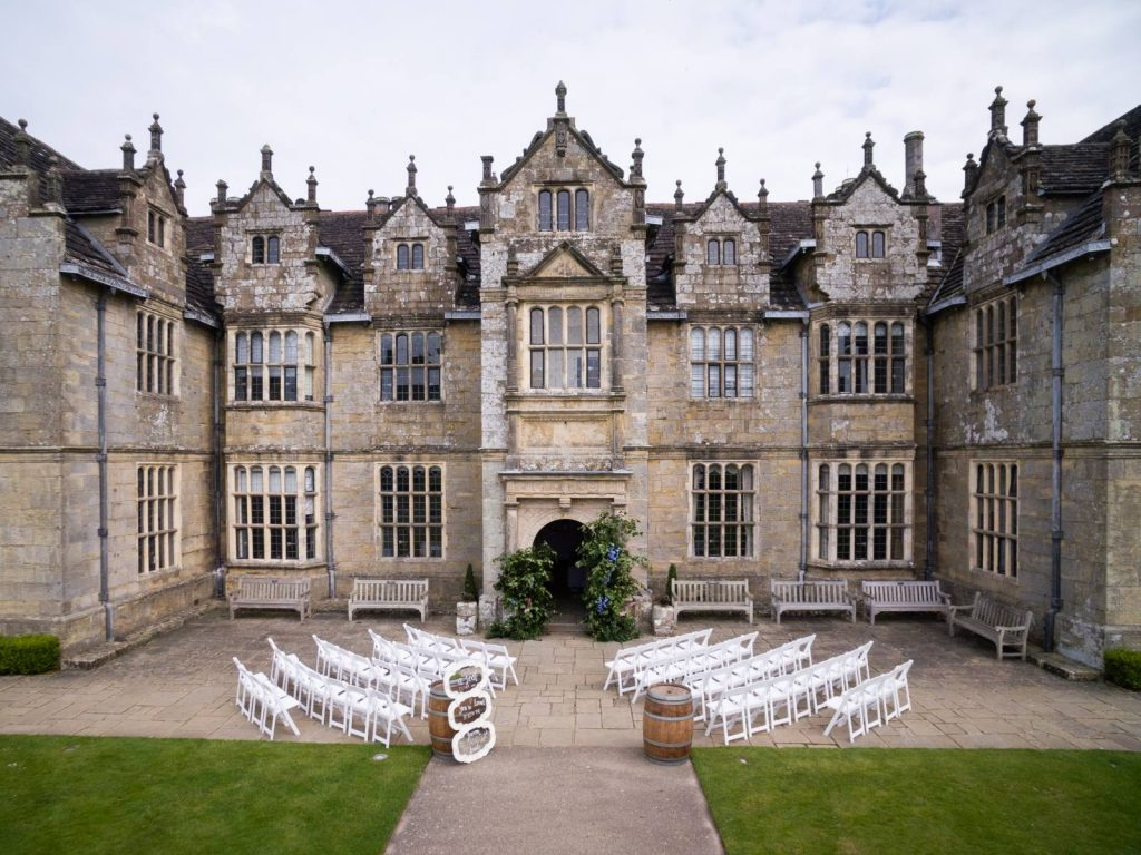 The front of Wakehurst Place set up for a wedding.