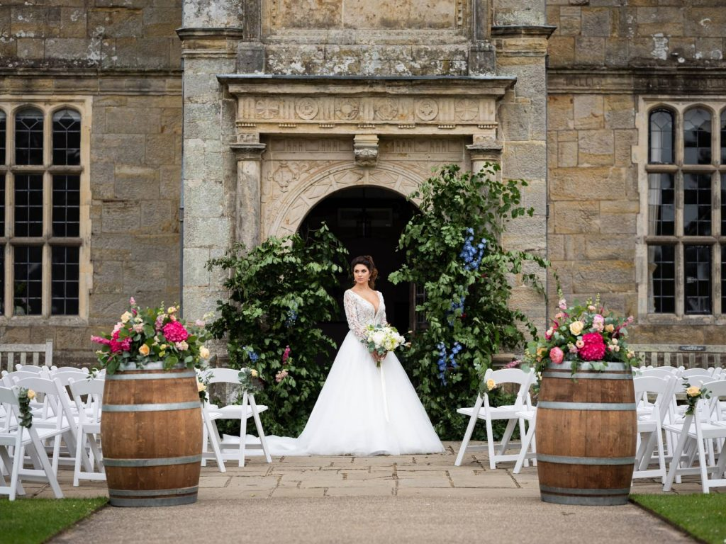 A bride in the entrance of a manor house