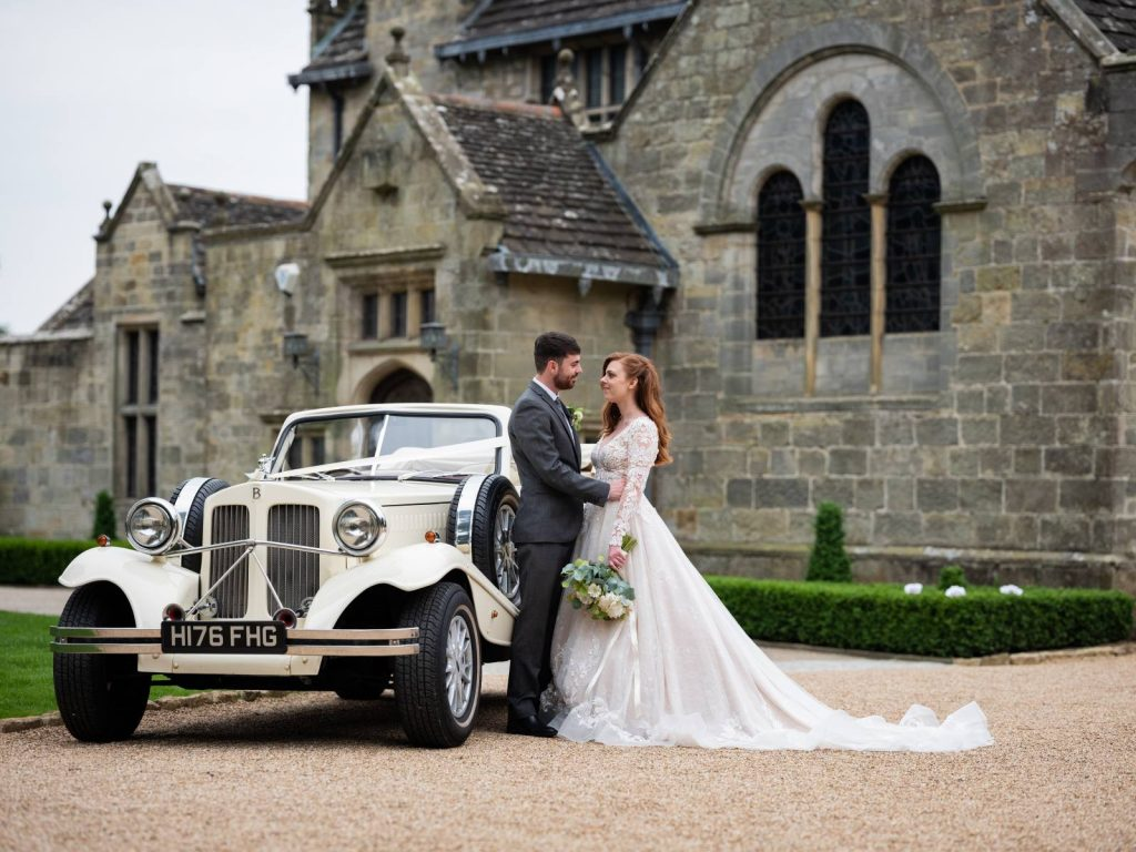 A vintage wedding car with bride and groom