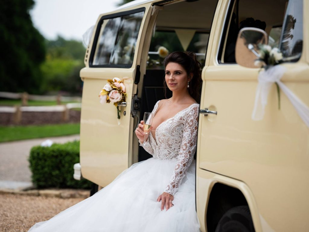 A bride sitting on a VW campervan