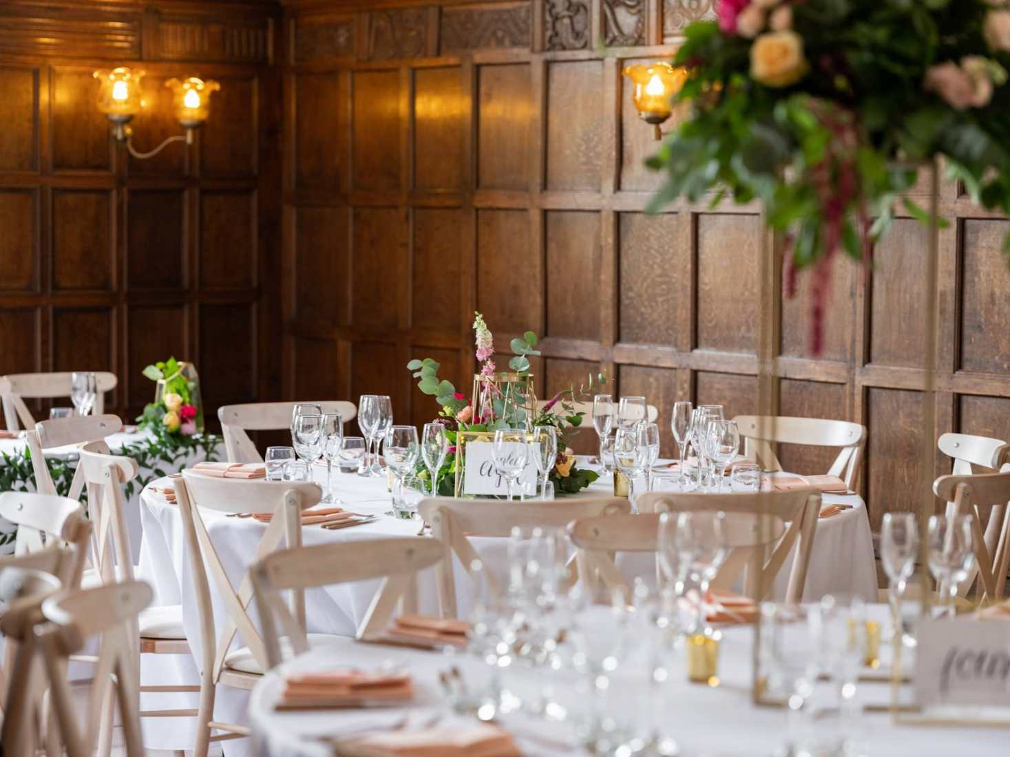 An oak panelled room set up for a wedding