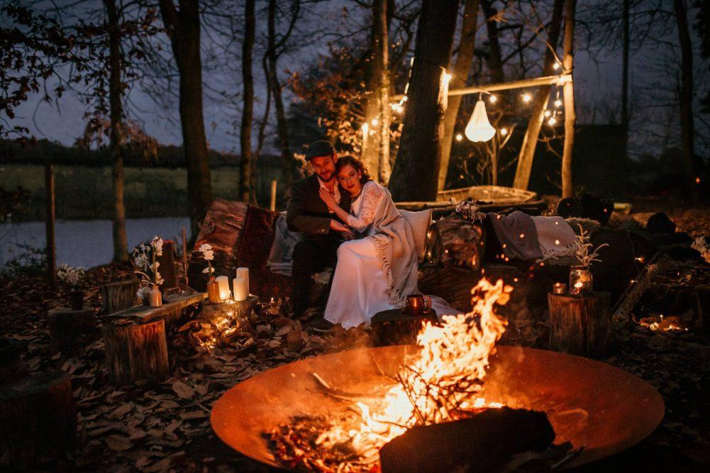 Bride & Groom Huddle by a Campfire